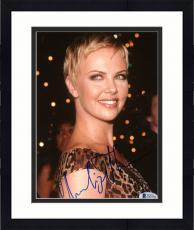"Framed Charlize Theron Autographed 8""x 10"" Wearing Leopard Dress Photograph - Beckett COA"