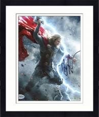 "Framed Chris Hemsworth Autographed 8"" x 10"" Thor: Fighting Hand in Air Grey Photograph - Beckett COA"