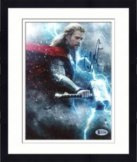 "Framed Chris Hemsworth Autographed 8"" x 10"" Thor: In Lightning Fighting Hand in Air Photograph - Beckett COA"