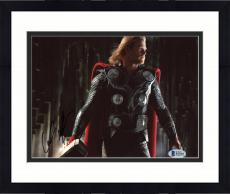 "Framed Chris Hemsworth Autographed 8"" x 10"" Thor: Standing Holding Hammer in Dark Place Photograph - Beckett COA"