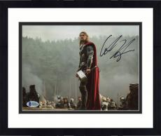 "Framed Chris Hemsworth Autographed 8"" x 10"" Thor- Standing on Rock Holding Thor Hammer Photograph - Beckett COA"