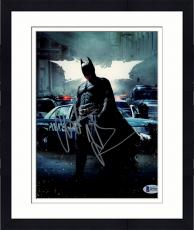 "Framed Christian Bale Autographed 8"" x 10"" The Dark Knight Rises Batman Standing in Street with Police & White Batman Symbol in Background Photograph - Beckett COA"