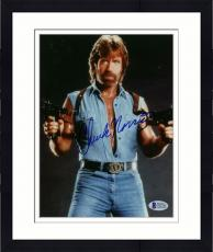 "Framed Chuck Norris Autographed 8""x 10"" Invasion USA Posing With Guns Photograph - Beckett COA"