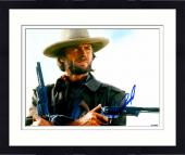 """Framed Clint Eastwood Autographed 11""""x 14"""" The Outlaw Josey Wales Holding Guns Photograph - PSA/DNA LOA"""