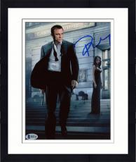 """Framed Daniel Craig Autographed 8"""" x 10"""" Casino Royale Holding Gun Walking Away Photograph - Beckett COA"""