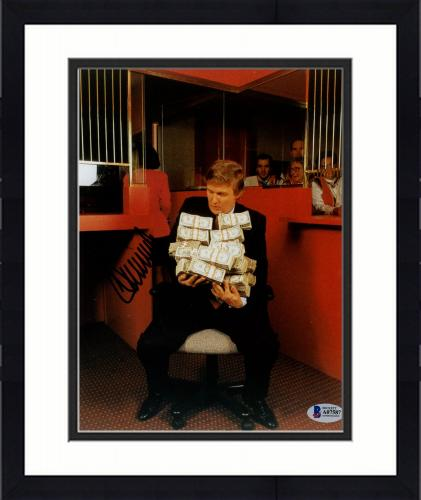 "Framed Donald Trump Autographed 8"" x 10"" Sitting Holding Money Bundles Photograph - Beckett LOA"
