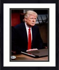 "Framed Donald Trump Autographed 8"" x 10"" The Apprentice Sitting Behind Desk Photograph - Beckett LOA"
