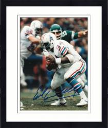 "Framed Earl Campbell Houston Oilers Autographed 8"" x 10"" Ducking Photograph"