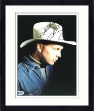 "Framed Garth Brooks Autographed 8"" x 10"" Jean Jacket & White Hat Black Background Photograph - Beckett COA"