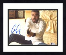 "Framed George Clooney Autographed 8"" x 10"" Burn After Reading Holding Gun With Surprised Look Photograph - Beckett COA"