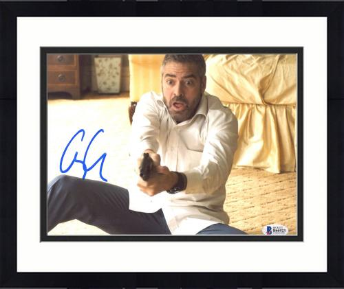 """Framed George Clooney Autographed 8"""" x 10"""" Burn After Reading Holding Gun With Surprised Look Photograph - Beckett COA"""