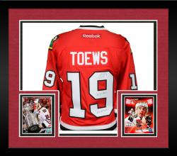 Framed Jonathan Toews Chicago Blackhawks Autographed Red Reebok Premier Jersey with Multiple Inscriptions