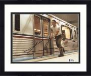 """Framed Keanu Reeves Autographed 8"""" x 10"""" Speed In Subway Station Photograph - Beckett COA"""
