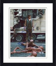 "Framed Norman Reedus Autographed 8"" x 10"" Standing in Zombies Photograph - Beckett COA"