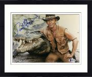 "Framed Paul Hogan Autographed 8""x 10"" Crocodile Dundee Sitting Next To Crocodile Photograph - Beckett COA"