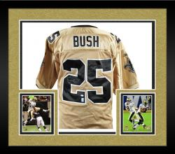 Framed Reggie Bush Autographed Jersey - Reebok Gold Mounted Memories