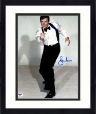 "Framed Roger Moore Autographed 11"" x 14"" James Bond Pointing Gun Pose Photograph - PSA/DNA COA"