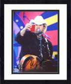 "Framed Toby Keith Autographed 8"" x 10"" Playing Guitar Holding Red Solo Cup Photograph - Beckett COA"