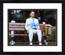 "Framed Tom Hanks Autographed 8"" x 10"" Forrest Gump Sitting on Bench in Park with Suitcase & Gift Photograph - Beckett COA"