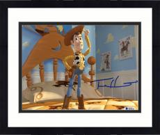 """Framed Tom Hanks Autographed 8"""" x 10"""" Toy Story Woody Standing on Bed Photograph - Beckett COA"""