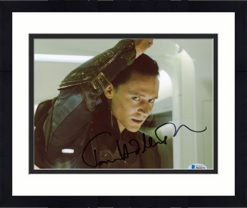 """Framed Tom Hiddleston Autographed 8"""" x 10"""" Thor Angry Fist Up Photograph - Beckett COA"""