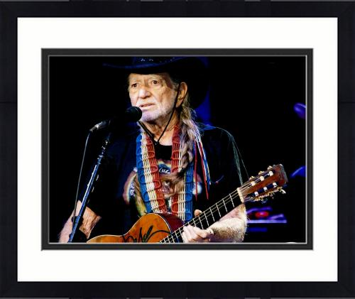 """Framed Willie Nelson Autographed 11""""X 14"""" Playing Guitar Wearing Black Hat With Black Background Photograph - PSA/DNA COA"""