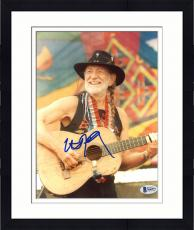 "Framed Willie Nelson Autographed 8"" x 10"" Playing Guitar With Colorful Flag in Background Photograph - Beckett COA"