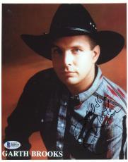 "Garth Brooks Autographed 8"" x 10"" Jean Jacket & Black Hat Red Background Photograph - Beckett COA"
