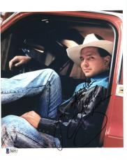 """Garth Brooks Autographed 8"""" x 10"""" Layed Back Sitting in Truck Photograph - Beckett COA"""