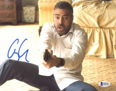"""George Clooney Autographed 8"""" x 10"""" Burn After Reading Holding Gun With Surprised Look Photograph - Beckett COA"""