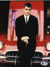 "George Clooney Autographed 8""x 10"" Standing in Front of Red Car Photograph - Beckett COA"
