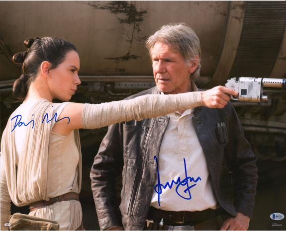 """Harrison Ford & Daisy Ridley Star Wars Autographed 16"""" x 20"""" Holding Blaster Photograph - BAS"""