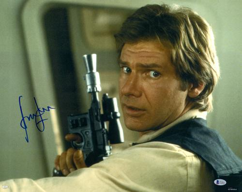 "Harrison Ford Star Wars Autographed 16"" x 20"" Holding Gun Photograph - BAS"