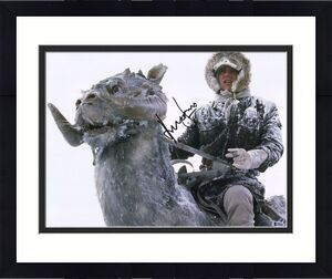 """Harrison Ford Star Wars Autographed 16"""" x 20"""" Riding Tauntaun Photograph Signed in Black - BAS"""