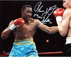Thomas Hearns Autographed 8'' x 10'' Horizontal Teal Trunks Photograph - Mounted Memories