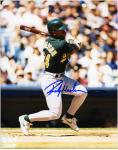 Rickey Henderson Oakland Athletics Autographed 8'' x 10'' Batting Green Uniform Photograph - Mounted Memories