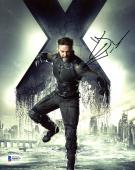 "Hugh Jackman Autographed 8"" x 10"" Xmen Wolverine Jumping with X in Background Photograph - Beckett COA"