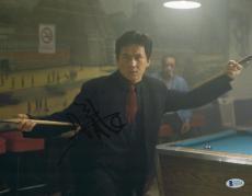 """Jackie Chan Autographed 11"""" x 14"""" Rush Hour Pool Stick Photograph -  BAS COA"""