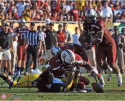 Jadeveon Clowney South Carolina Gamecocks Autographed 8'' x 10'' The Hit Photograph - Mounted Memories