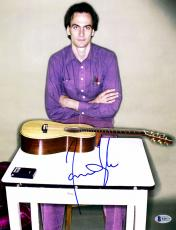 "James Taylor Autographed 11"" x 14"" Sitting with Guitar Photograph - Beckett COA"