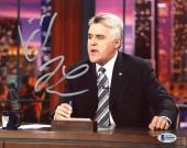 "Jay Leno Autographed 8"" x 10"" Sitting Behind Desk Photograph - Beckett COA"