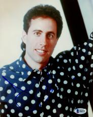 "Jerry Seinfeld Autographed 8"" x 10"" Leaning on Mirror Wearing Polka Dot Shirt Photograph - Beckett COA"