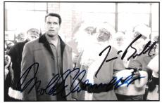 "JINGLE ALL the WAY"" Signed by ARNOLD SCHWARZENEGGER as HOWARD LANGSTON and JAMES BELUSHI as MALL SANTA 6.5x4 B/W Photo"