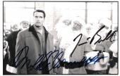 "JINGLE ALL the WAY"" Signed by ARNOLD SCHWARZENEGGER as HOWARD LANGSTON and JAMES BELUSHI as MALL SANTA 6.5x4 B/W Photo"