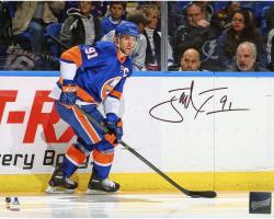 "John Tavares New York Islanders Autographed Skating With Puck 8"" x 10"" Photograph"