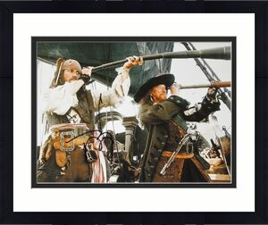Johnny Depp Signed - Autographed Pirates of the Caribbean 11x14 inch Photo - Guaranteed to pass BAS - Captain Jack Sparrow