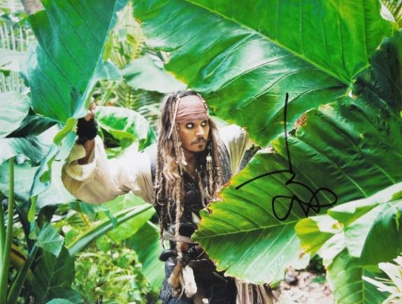 Johnny Depp Signed - Autographed Pirates of the Caribbean 11x14 inch Photo - Guaranteed to pass BAS