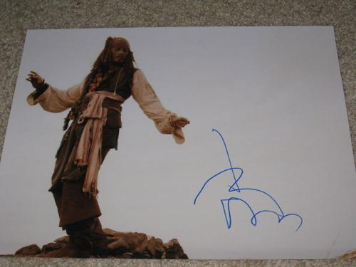 JOHNNY DEPP SIGNED 11x14 PIRATES OF THE CARIBBEAN B