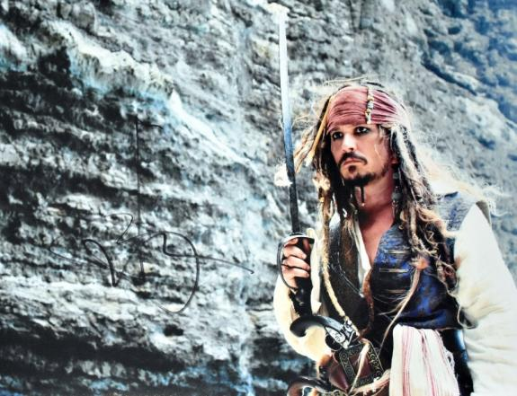 Johnny Depp Signed - Autographed Pirates of the Caribbean - Captain Jack Sparrow 11x14 inch Photo - Guaranteed to pass JSA