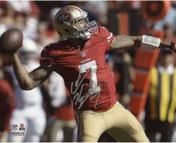 Colin Kaepernick San Francisco 49ers Autographed 8'' x 10'' Red Uniform Throwing Photograph - Mounted Memories